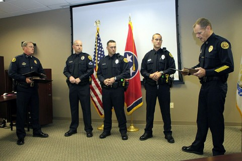 Deputy Chief Mike Parr, Officer Mark Wilson, Officer Jeff Danault, Officer Nathan Lee, and Chief Al Ansley—Chief reading the award citation. (Photo by CPD-Jim Knoll)