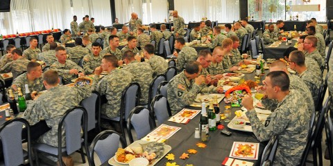 Soldiers of 2nd Brigade Combat Team, 101st Airborne Division (Air Assault) eat a Thanksgiving meal together at the brigade's dining facility at Fort Campbell, KY, Nov. 22nd The dinner brought Soldiers and participating family members together to share a festive holiday meal in a welcoming atmosphere. (U.S. Army Photo By Spc. Shawn Denham, PAO, 2nd BCT, 101st Abn. Div.)
