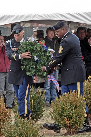 Col. Dan Walrath, commander, 2nd Brigade Combat Team, 101st Airborne Division (Air Assault) and Command Sgt. Major Alonzo Smith, command sergeant major, 2nd BCT, place a wreath at Fort Campbell's monument to the Gander tragedy during the annual remembrance ceremony, Dec. 12th.  (U.S. Army photo by Sgt. Joe Padula, 2nd BCT PAO, 101st Abn. Div.)