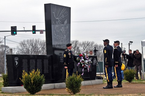Col. Dan Walrath, commander, 2nd Brigade Combat Team, 101st Airborne Division (Air Assault) and Command Sgt. Major Alonzo Smith, command sergeant major, 2nd BCT, salute at Fort Campbell's monument to the Gander tragedy during the annual remembrance ceremony, The names of the 248 Screaming Eagle Soldiers who died in the crash of Arrow Airlines flight 1285, December 12th, 1985, are etched into the face of the monument. (U.S. Army photo by Sgt. Joe Padula, 2nd BCT PAO, 101st Abn. Div.)
