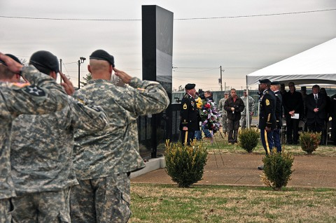 Soldiers of the 2nd Brigade Combat Team, 101st Airborne Division (Air Assault), Col. Dan Walrath, commander, 2nd BCT and Command Sgt. Major Alonzo Smith, command sergeant major, 2nd BCT, salute while taps is played at Fort Campbell's monument to the Gander tragedy during the annual remembrance ceremony, Dec. 12th. Arrow Airlines flight 1285 crashed December 12th, 1985, killing the 248 Screaming Eagle Soldiers returning home from a tour in Sinai, Egypt. (U.S. Army photo by Sgt. Joe Padula, 2nd BCT PAO, 101st Abn. Div.)