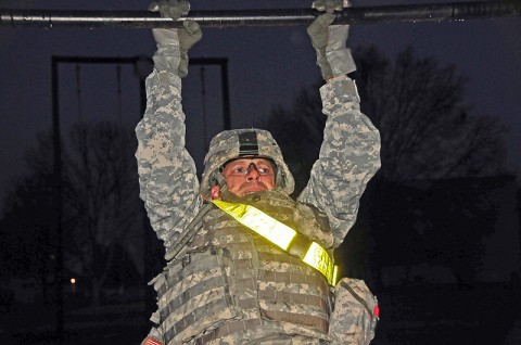 Staff Sgt. Jeffrey Craig, with Company G, 1st Battalion, 320th Field Artillery Regiment, 2nd Brigade Combat Team, 101st Airborne Division (Air Assault), conducts pull-ups in the pre-dawn darkness during the latest 'Top Guns Blitz' at Fort Campbell, Ky, Dec. 7th. The platoon leaders of Top Guns participated in the event which focused on physical and mental development. (U.S. Army Photo By Spc. Shawn Denham, PAO, 2nd BCT, 101st Abn. Div.)