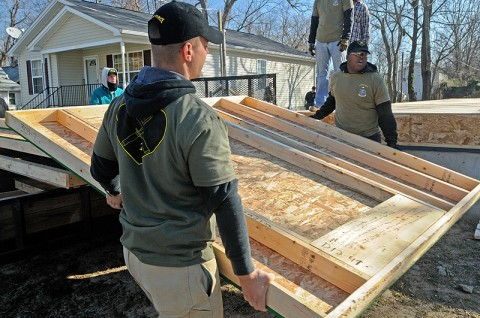 2nd Lt. Mark Patton and Pvt. 1st Class Shammah Nasheed, both with 2nd Battalion, 502nd Infantry Regiment, 2nd Brigade Combat Team, 101st Airborne Division (Air Assault), carry pre-made walls to be installed at a house under construction in Hopkinsville, KY, Dec. 10th. Strike Force Soldiers volunteered with Habitat for Humanity to help construct a home for a family in need. (U.S. Army Photo By Spc. Shawn Denham, PAO, 2nd BCT, 101st Abn. Div.)