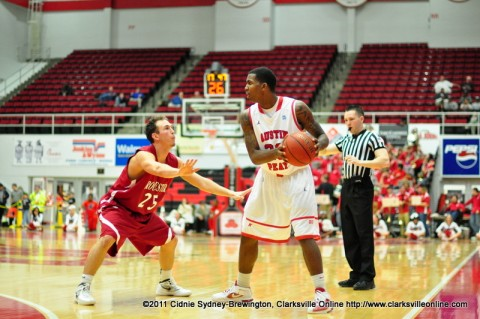 Melvin Baker sets up the half court offense during Austin Peay's win over Rochester. Baker ended the game with 10 points.
