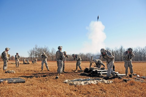 The First Strike mortar teams of 1st Battalion, 502nd Infantry Regiment, 2nd Brigade Combat Team, 101st Airborne Division (Air Assault), fire for effect during team and squad live-fire exercises in Fort Campbell's training area, Nov. 17th. The battalion trained in the field from Nov. 1st - Dec. 14th, calling it Back to the Woods. (U.S. Army photo by Sgt. Joe Padula, 2nd BCT PAO, 101st Abn. Div.)