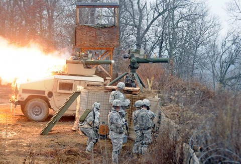 Pvt. 1st Class Collin R. Hoffmeyer, a gunner with Troop A, 1st Squadron, 32nd Cavalry, 1st Brigade Combat Team, 101st Airborne Division, fires a Tube-Launched, Optically-Tracked, Wire Command Data Link Missile from the turret of a Humvee Dec. 6th at Observation Point-12 in Fort Knox, KY. The squadron was training here in order to complete their gunnery tables. (Photo by Sgt. Jon Heinrich)