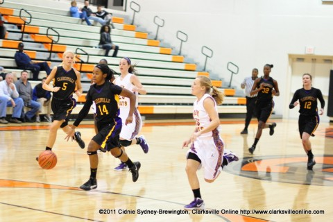 Clarksville High School Lady Wildcats get out on a fast break during their 56-34 win over the Lawrence County Lady Wildcats.