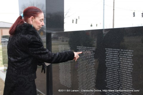 Malinda Parris looks at her husband's name on the Gander Crash Memorial