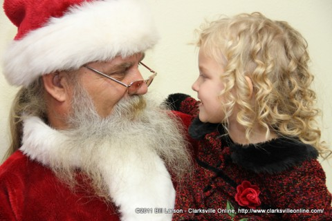 Santa Claus visiting with a young lady at the Woodlawn Papa Rock Travel Center on Saturday
