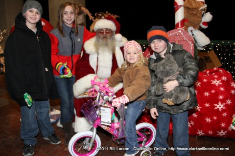 A young girl sitting on the bicycle she was just given at the 2011 Christmas on the Cumberland