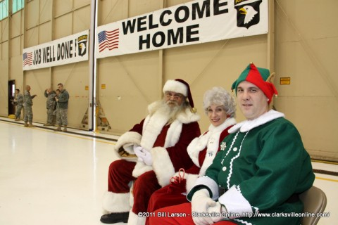 Santa and Mrs. Claus along with an elf at the December 22nd Welcome Home Ceremony at Fort Campbell