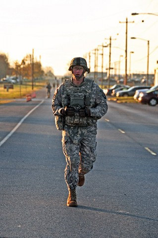 Capt. Patrick Glass, commander, Company C, 526th Brigade Support Battalion, 2nd Brigade Combat Team, 101st Airborne Division (Air Assault), runs on Fort Campbell's Tennessee Ave. in full combat gear for a total of one-mile and a half while taking the Iron Strike Combat Physical Fitness Test, Nov. 10th. The ISCPFT is designed to better prepare Strike Soldiers for future combat operations. (U.S. Army photo by Sgt. Joe Padula, 2nd BCT PAO, 101st Abn. Div.)