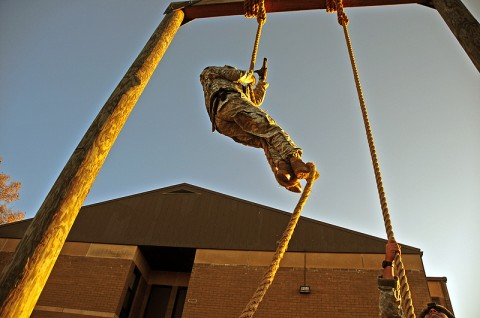 Col. Dan Walrath, commander, 2nd Brigade Combat Team, 101st Airborne Division (Air Assault), climbs Strike's air assault ropes in full combat gear while taking the Iron Strike Combat Physical Fitness Test, Nov. 10th. The ISCPFT is designed to better prepare Strike Soldiers for future combat operations. (U.S. Army photo by Sgt. Joe Padula, 2nd BCT PAO, 101st Abn. Div.)