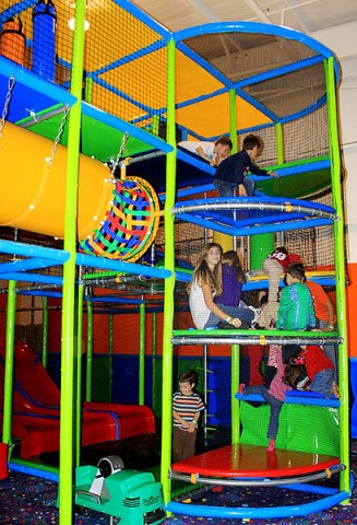 Children enjoying the multi-level play scape.