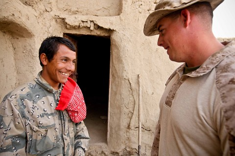 Sergeant James Carney IV of Clarksville, Tennessee, interacts with an Afghan Border Policeman after training. The motor transport operator for Border Advisor Team 1 is one of more than 20 service members on the team who brings their own expertise to help make the ABP a better fighting force. (Photo by Cpl. Marco Mancha)