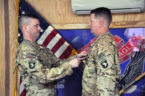 Col. Todd Royar (left), the commander of the 159th Combat Aviation Brigade, promotes Tyler, Texas, native Kyle Hill to chief warrant officer five during a ceremony at Forward Operating Base Wolverine, Afghanistan, Dec. 1st. (Courtesy Photo)