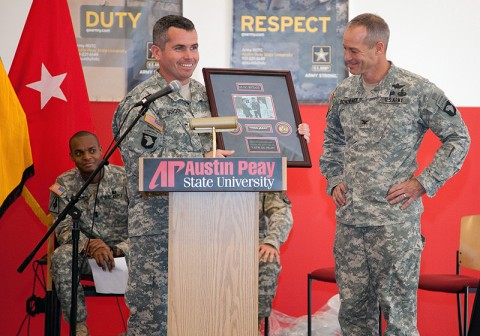 Lt. Col. Robert Gordon (left) presents Col. Paul Bontrager with a plaque honoring his service. (Photo by Beth Liggett, APSU photographer)