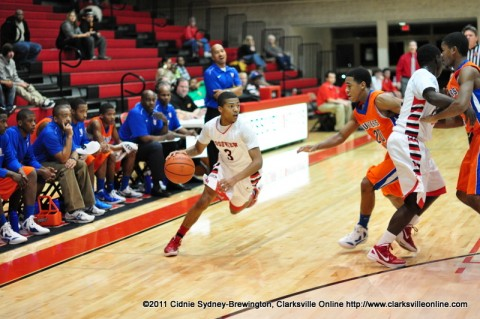 Rossview High School's Chris Williams is driving against Hunters Lane in the Hawks' 64-43 loss Thursday night.