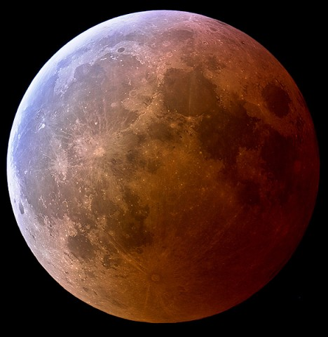 This photo, taken by Jens Hackman of Weikersheim, Germany, during a total lunar eclipse in March 2007, shows the turquoise outskirts and red core of Earth's shadow sweeping across the face of the Moon.