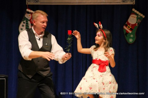 Magician Russ Nowack astounds a young girl with one of his magic tricks at the last Magic at the Museum.