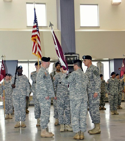 Command Sergeant Major Smith on the left preparing to receive the Warrior Transition Battalion's Color. (Photo by CPD-Jim Knoll)