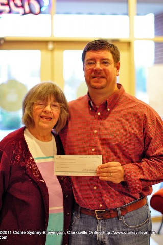 Michael Clark, winner of the Lasaters Christmas Giveaway, and his mother, Jeane Clark, just after receiving the $1000 giveaway.