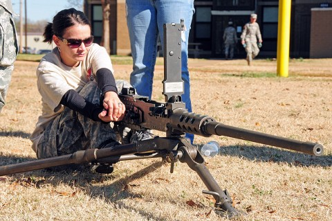 Molli Igou, wife of Spc. Eduardo Mendez with 1st Squadron 75th Cavalry Regiment, 2nd Brigade Combat Team, 101st Airborne Division (Air Assault), charges a Browning M2 .50 caliber machine gun during the 'Spouse Spur Ride' at Fort Campbell, KY, Nov. 18th. Weapons familiarization was one of several events meant to demonstrate to the spouses what their husbands do on a daily basis. (U.S. Army Photo By Spc. Shawn Denham, PAO, 2nd BCT, 101st Abn. Div.)
