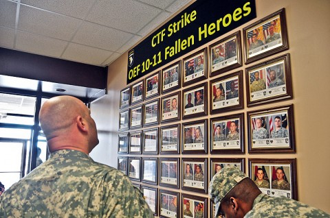 Spc. Michael Waskom, previously with Company A, 2nd Battalion, 502nd Infantry Regiment, 2nd Brigade Combat Team, 101st Airborne Division (Air Assault), looks at the Combined Task Force Strike Operation Enduring Freedom 10-11 Fallen Heroes Wall outside of the Strike Store during a visit to the 2nd BCT, Jan. 12th. Waskom was wounded Sept. 5th, 2010 from an Improvised Explosive Device and is currently with Fort Campbell's Warrior Transition Battalion, (U.S. Army photo by Sgt. Joe Padula, 2nd BCT PAO, 101st Abn. Div.)