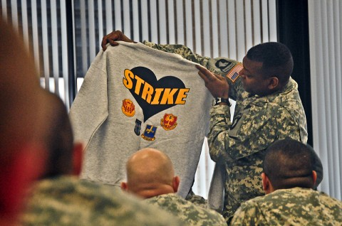 Command Sgt. Maj. Alonzo Smith, command sergeant major, 2nd Brigade Combat Team, 101 Airborne Division (Air Assault) holds up a Strike sweat shirt intended for the 2nd BCT Wounded Warriors during their visit back to Strike, Jan. 12th. The wounded warriors are currently assigned to Fort Campbell's Warrior Transition Battalion and still carry a strong bond with the 2nd BCT. (U.S. Army photo by Sgt. Joe Padula, 2nd BCT PAO, 101st Abn. Div.)