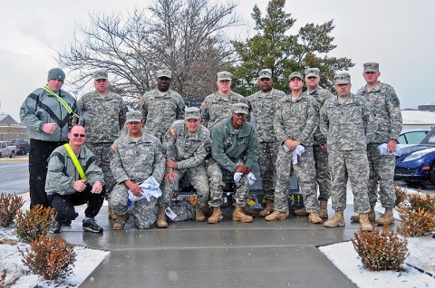Command Sgt. Maj. Alonzo Smith, command sergeant major, 2nd Brigade Combat Team, 101 Airborne Division (Air Assault) and 12-Strike Wounded Warriors, stand in front of the Combined Task Force Strike Fallen Hero Monument during a visit back to Strike, Jan. 12th. The wounded warriors are currently assigned to Fort Campbell's Warrior Transition Battalion and still carry a strong bond with the 2nd BCT. (U.S. Army photo by Sgt. Joe Padula, 2nd BCT PAO, 101st Abn. Div.)