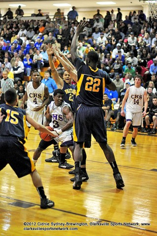 Clarksville's Daijon Williams trapped in a Northeast triple team. In a great upset for Northeast, the Clarksville High Wildcats win it 69-60.