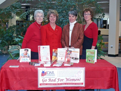 Chapter Registrar Elsie Smith, Mayor Kim McMillan, Library Director Martha Hendricks, and Chapter Regent Gail Longton gather to discuss Go Red For Women.  (Photo by Becky Poppleton)