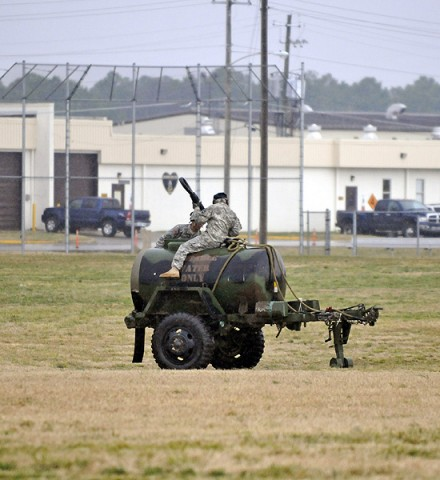 Staff Sgt. Michael N. D'amato, a field artillery meteorological surveyor with Headquarters and Headquarters Battery, 2nd Battalion, 320th Field Artillery, 1st Brigade Combat Team, 101st Airborne Division, and Pvt. Gary V. Braswell, a meteorological crewmember also with HHB, rig an air assault sling load to a M149 Water Buffalo Jan. 25th at Johnson Field here. (Photo by Sgt. Jon Heinrich)