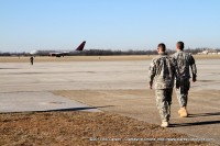Maj. Gen. McConville and an Aide walk out to meet the returning flight