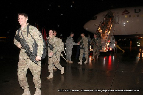 A 159th Combat Aviation Brigade Soldier breaks into a smile as he heads for the hangar and a chance to see his family