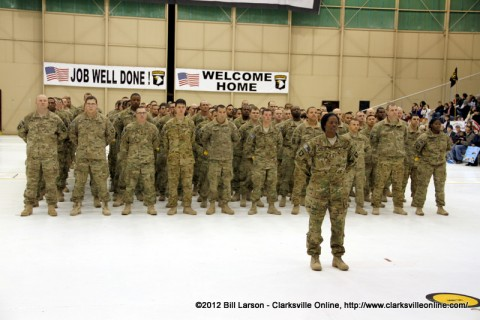 The 154 returning soldiers of the 159th Combat Aviation Brigade stand proudly before their families and loves ones