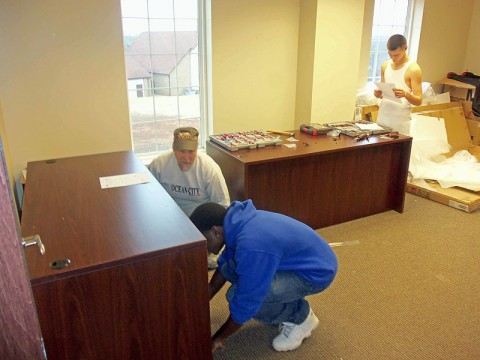 LEAP Interns help a business move into the Emmanuel Family Life Center.