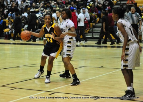 Northeast's Desiree Wilks and Kenwood's Blake Jenkies guard each other in Kenwood's 61-40 District 10-AAA victory on January 27th, 2012.