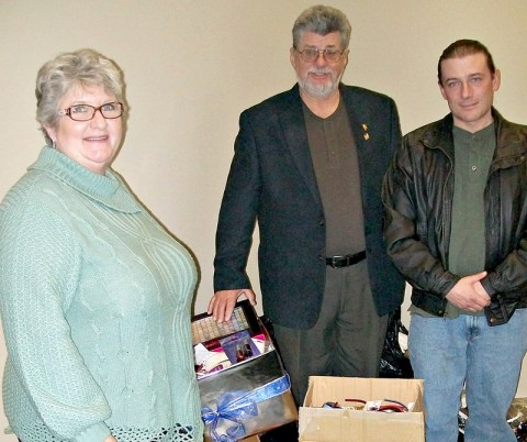 Planters Bank employees and customers recently donated several boxes of clothing and personal care items for women going through the Life Center Foundation's Phoenix Program. Pictured from left to right are Jan Greene, Planters Bank branch manager; Bill Irby, Life Center Foundation founder; and David Adler, Phoenix Program director