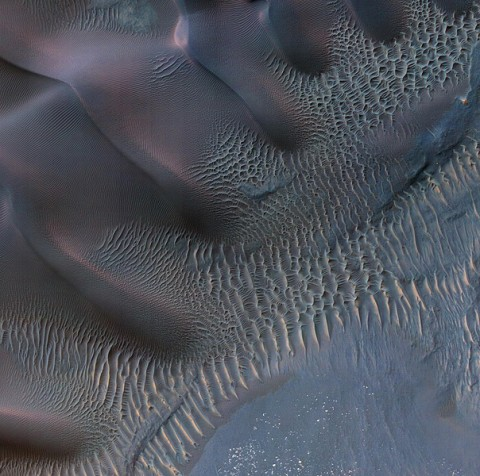 This enhanced-color image shows sand dunes trapped in an impact crater in Noachis Terra, Mars. (Image credit: NASA/JPL-Caltech/Univ. of Arizona)