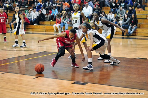 Rossview's Dayisha Skelton (left) and Northeast's Nataszja Freemon chase a loose ball. Rossview won the game 68-32.