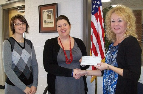 Planters Bank Branch Manager and Assistant Vice President Stacey Wenzler presents a check to Rossview High School Assistant Principal Schanda Dowdy and Librarian Valerie Meadows.
