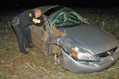 Clarksville Police Officer Tom Johnson investigates the crash scene. (Photo by CPD - Jim Knoll)