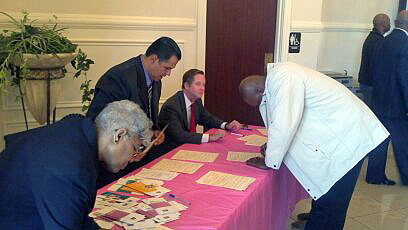 Senator Tim Barnes and Pastor Tommy Vallejos assist members of First Missionary Baptist Church in registering to vote.