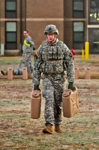 Sgt. Corey Allen, a fire support specialist with Headquarters and Headquarters Company, 2nd Brigade Combat Team, 101st Airborne Division (Air Assault), carries fully loaded water jugs for 300-meters during a combat focused physical training event. (U.S. Army photo by Sgt. Joe Padula, 2nd BCT PAO, 101st Abn. Div.)