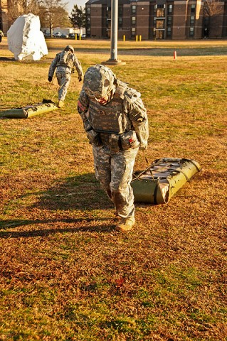 Sgt. 1st Class Abby Blaisdell, the civil affairs specialist with Headquarters and Headquarters Company, 2nd Brigade Combat Team, 101st Airborne Division (Air Assault), drags a weighted medical liter 100-meters during a combat focused physical training event. (U.S. Army photo by Sgt. Joe Padula, 2nd BCT PAO, 101st Abn. Div.)