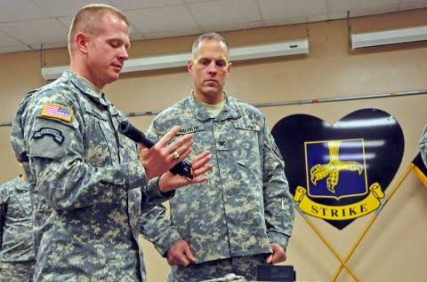 Maj. Vinson Morris, assistant product manager, Project Manager Soldier Weapons, demonstrates the elements of the new M26 Modular Accessory Shotgun System to Col. Dan Walrath, commander, 2nd Brigade Combat Team, 101st Airborne Division (Air Assault), at Strike Academy, Feb. 7th. The 2nd BCT, also known as the Strike Brigade, is the first unit in the Army to be issued the future weapon. (U.S. Army photo by Sgt. Joe Padula, 2nd BCT PAO, 101st Abn. Div.)
