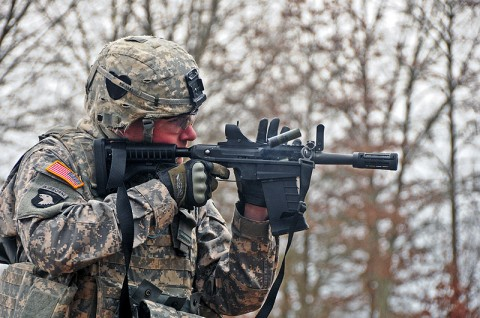 "Sgt. Rhys McMahon, a combat engineer with Company A, 2nd Brigade Special Troops Battalion, 2nd Brigade Combat Team, 101st Airborne Division (Air Assault), fires the stand alone version of the M26 Modular Accessory Shotgun System at Fort Campbell's Range 44b, Feb. 10th. After firing the weapon system McMahon said, ""This would have helped us out quite a few times when we were in Afghanistan."" (U.S. Army photo by Sgt. Joe Padula, 2nd BCT PAO, 101st Abn. Div.)"