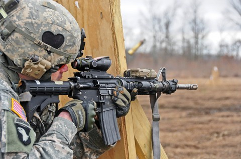 Capt. James Nardelli, part of a deploying Security Force Assistance Team with the 2nd Battalion, 502nd Infantry Regiment, 2nd Brigade Combat Team, 101st Airborne Division (Air Assault), fires at a target during a stress shoot training exercise at Fort Campbell's Range 40a, Feb. 16th. The stress shoot training exercise conditions Soldiers to effectively hit their targets in highly intense situations. (U.S. Army photo by Sgt. Joe Padula, 2nd BCT PAO, 101st Abn. Div.)