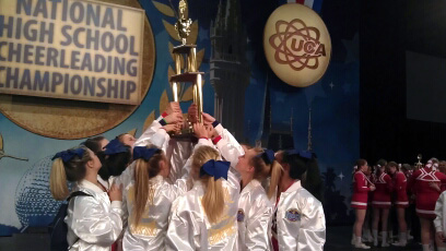 Montgomery Central High School Varsity Cheerleaders holding up their trophy.
